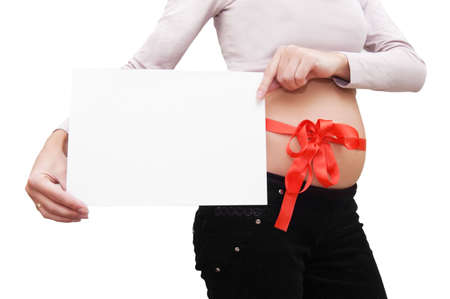 Woman' s belly with blank board and red ribbon over white Stock Photo - 5710107