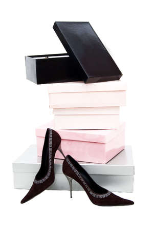 Pile of boxes and brown woman shoes over white Stock Photo