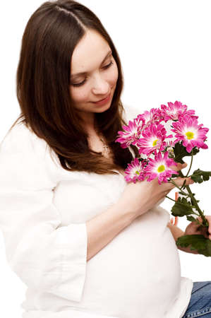 Beautiful pregnant woman holding belly with flowers Stock Photo - 5752043