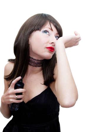 eau de perfume: Woman applying perfume on her over white
