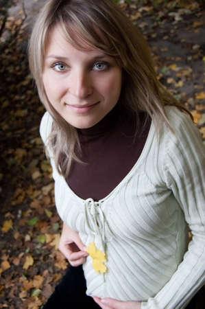 Pretty pregnant woman over autumn background photo
