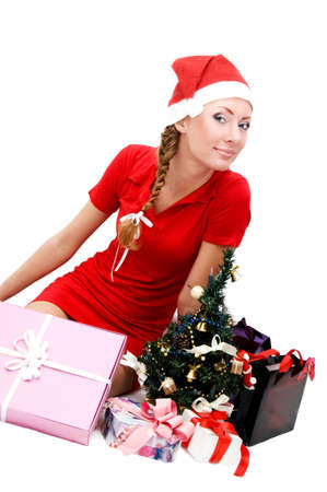 Santa woman helper with Christmas tree and gifts over white Stock Photo - 6024444