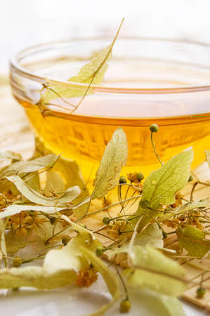 Cup of tea from dry lime-tree flower Stock Photo - 6168854
