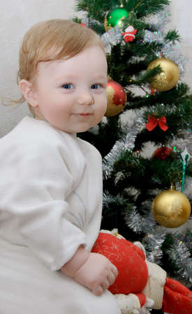 Adorable baby boy on Christmas tree background Stock Photo - 6228065