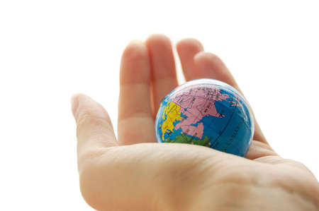 Globe in human palm isolated on white Stock Photo - 6303110