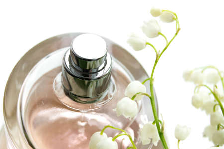 Bottle of perfume and lilies-of-the-valley photo