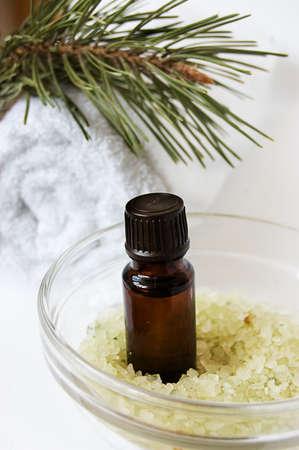 Bottle of fir tree oil and salt over white Stock Photo - 6912066