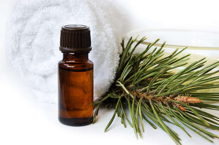 Bottle of fir tree oil and towel over white Stock Photo - 6912065