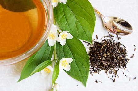Cup of green tea and jasmine Stock Photo - 7089117