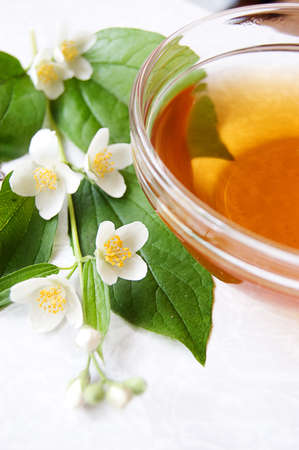 Cup of green tea with jasmine over light back Stock Photo - 7202325