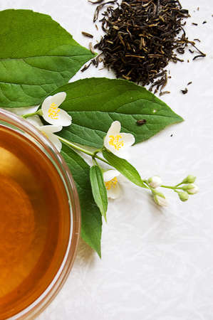 Cup of green tea with jasmine over light back Stock Photo - 7233106