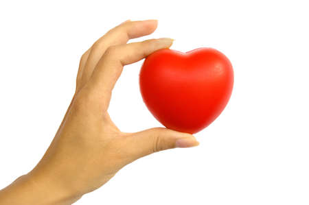 Red heart in womans hand isolated on white Stock Photo