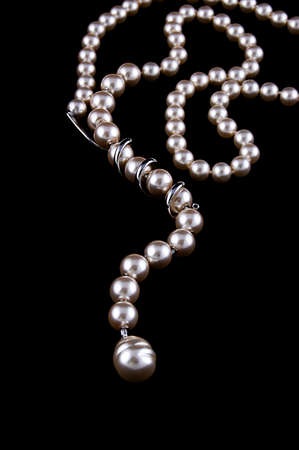 pearl jewelry: White pearls necklace on black background Фото со стока