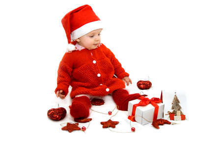 Baby dressed as Santa helper with Christmas decoration Stock Photo - 8208241