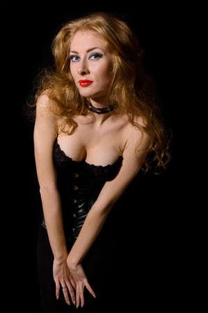 Beautiful fashion woman vamp style over black Stock Photo - 8407081