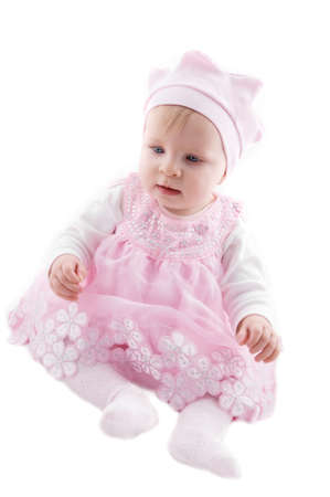 Baby girl in pink dress over white background photo