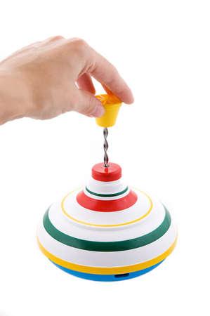 whirligig: Hand playing whirligig isolated on white