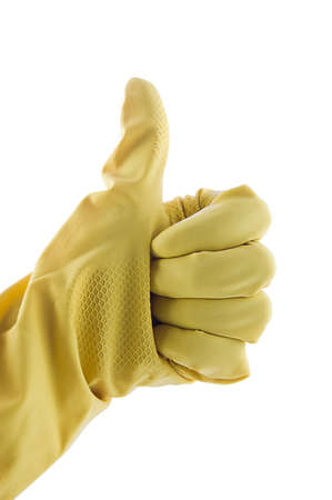 Thumb up in yellow working glove on white photo