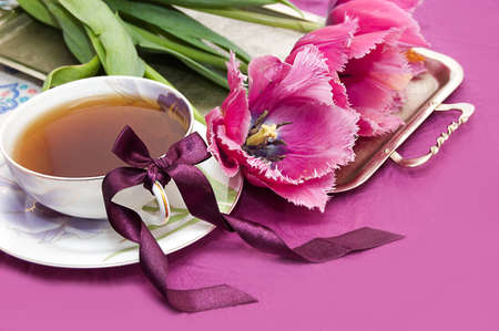 Violet tulips and cup of tea on tray Stock Photo - 9071230