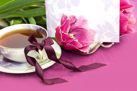 Cup of tea and magenta tulips with blank note Stock Photo - 9071229