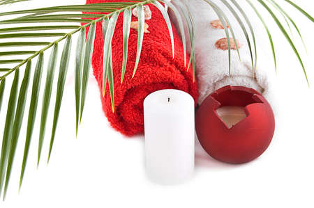 Candles and bath towels with palm branch Stock Photo - 9130874