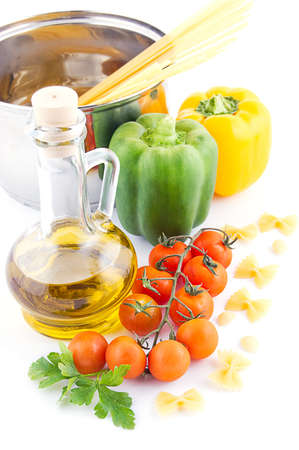 Pasta ingredients with olive oil, tomatoes, pepper and greens