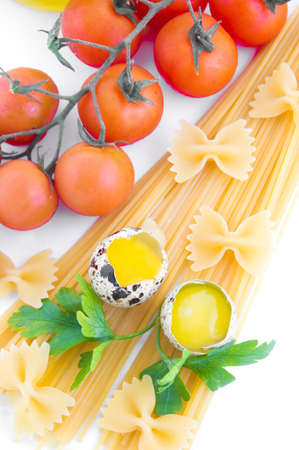 Pasta ingredients with cherry tomato, eggs and greens photo