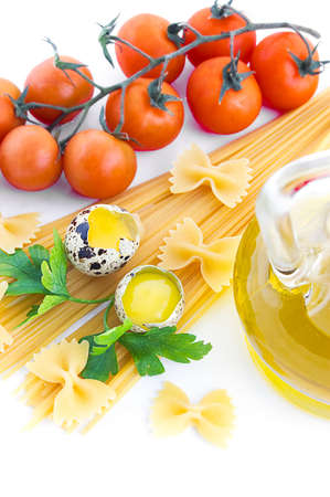 Pasta ingredients with cherry tomato, greens, eggs and olive oil photo