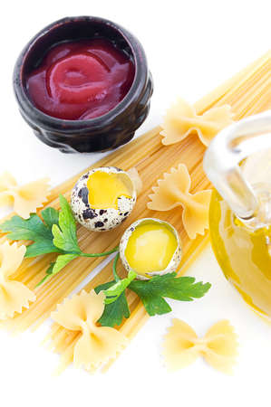Pasta ingredients with olive oil, eggs, greens and ketchup photo