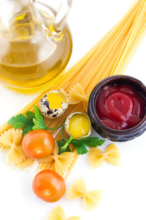 Pasta ingredients with cherry tomato, eggs, ketchup and greens photo