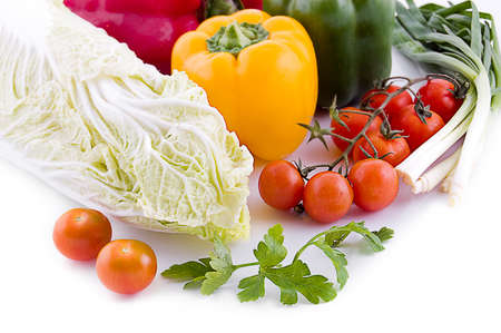 Cabbage with cherry tomatoes, lettuce and pepper isolated on white background Stock Photo - 9325954