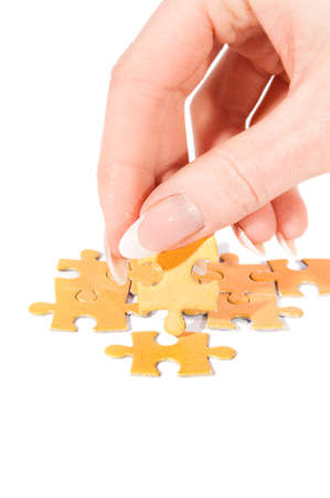 Woman hand putting right piece in puzzle Stock Photo - 9325952