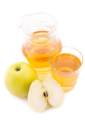 Jug and glass of apple juice over white Stock Photo - 9334599