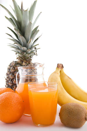 Jug and glass of multivitamin juice with fruits Stock Photo - 9334602