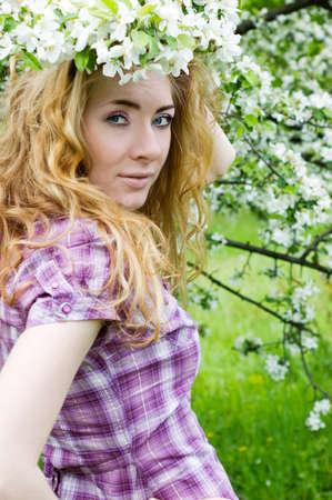 redheaded: Redheaded woman in cherry tree blossom