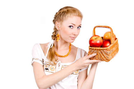 Redheaded woman holding basket of apples on white Stock Photo - 9679286
