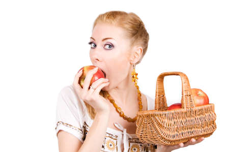 Redheaded woman with basket biting apple over white photo