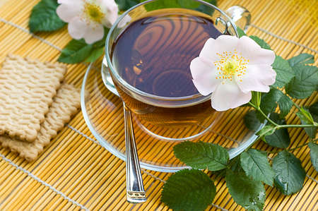 Cup of tea with dog-rose blossom Stock Photo - 9679293