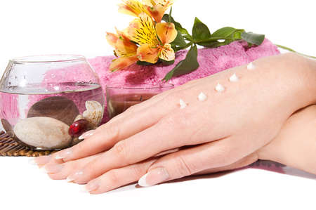 Woman hands with cream on spa treatment photo