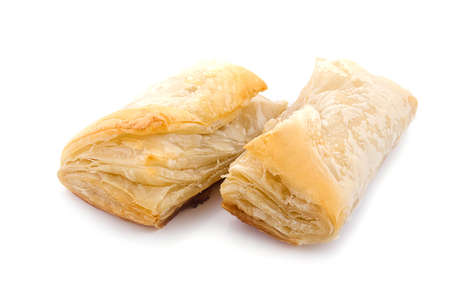 Puff pastry with potato and cabbage over white photo