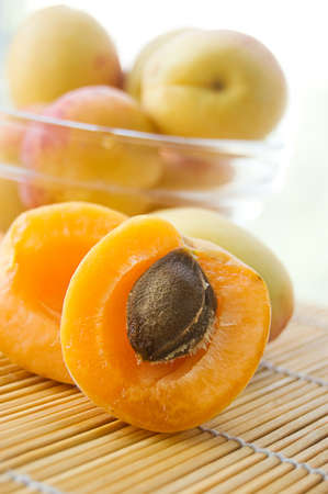Fresh apricots in plate on lighten back Stock Photo - 9973430