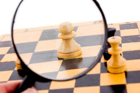 magnified: Pawn chess under magnifying glass