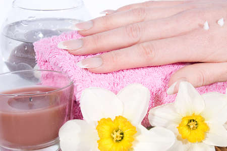 Woman hand with manicure on spa treatment photo