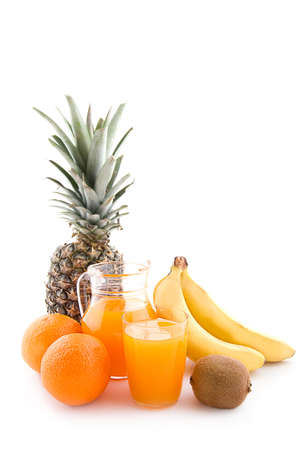Jug and glass of multivitamin juice with fruits Stock Photo - 10368064