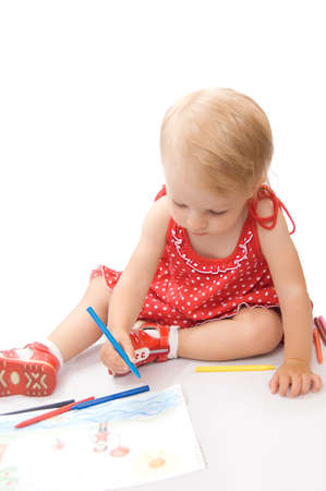 Little baby girl drawing at her album over white photo