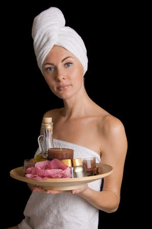 Woman with towel with spa products over black Stock Photo - 10543627