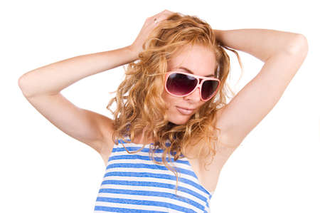striped vest: Redheaded woman in striped vest and pink glasses over white Stock Photo