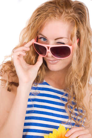 Woman in striped vest and pink glasses winking over white photo