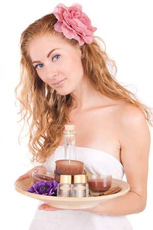 Woman with pink flower and spa products over white Stock Photo - 10590125
