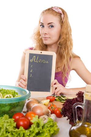 Pretty woman with menu board and vegetables over white Stock Photo - 10769712